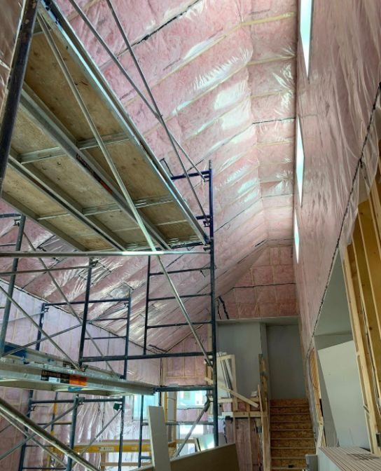insulation being installed on the ceiling