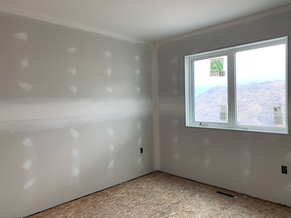 empty room with taped drywall