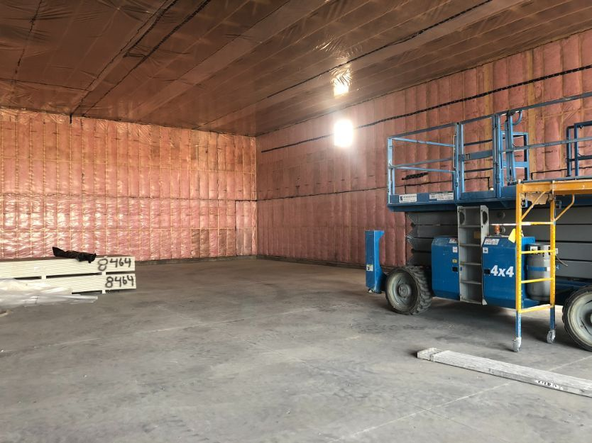interior view of a commercial space after wall and ceiling insulation