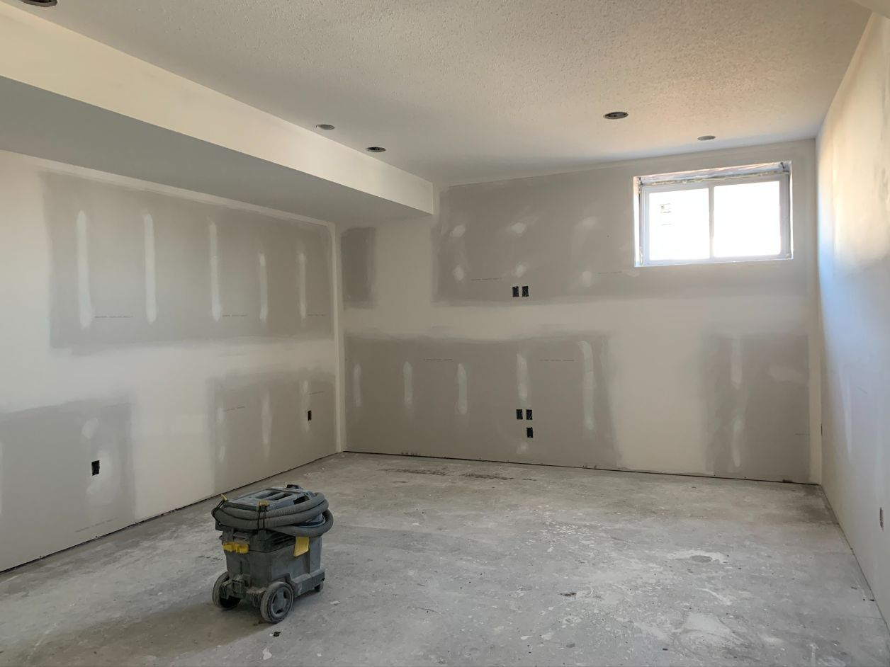 taped drywall with painted ceiling